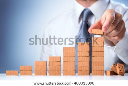 businessman building the...