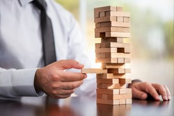 Businessman Building Up Tower, Challenge In Business Concept