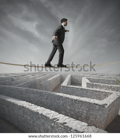 Businessman bypass the maze with the rope