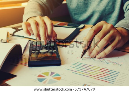 Businessman calculate finance and thinking about problem in home office.