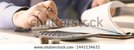 Businessman Calculate Funds Tax Report Concept. Accountant Married Man Counting Financial Data Using Calculator, Chart. Corporate Analyzes Economy Balance. Salary Growth Calculation Job