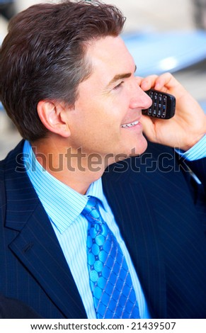 Businessman calling by cellular