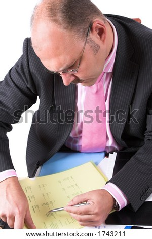 Businessman carefully checking the content of his documents