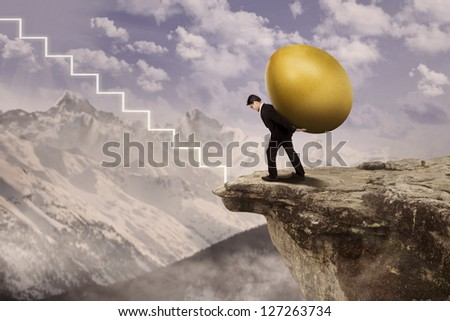 Businessman carry gold egg on top of a mountain towards virtual stairs