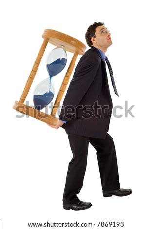 Businessman carrying a hourglass - concept for working under the pressure of a deadline - isolated