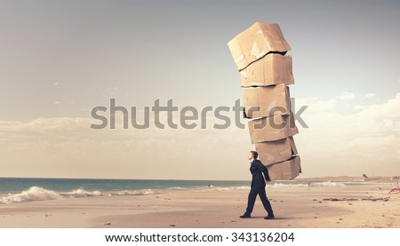 Businessman carrying big stack of carton boxes #343136204
