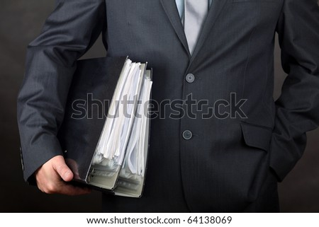 Businessman carrying file folders