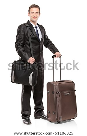 Businessman carrying his laptop in a shoulder bag and his luggage, isolated on white