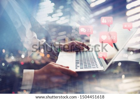 Businessman chats with his friend through laptop