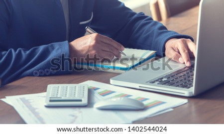 businessman check the work documents in office,The media reaches the operational guidelines