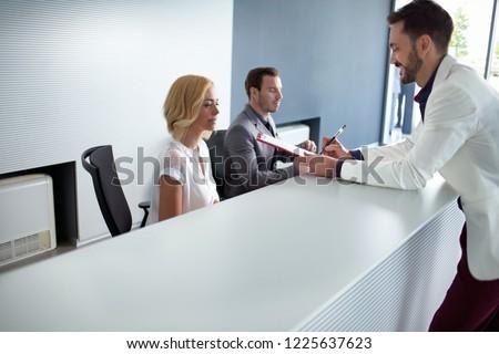 Businessman checking at reception desk