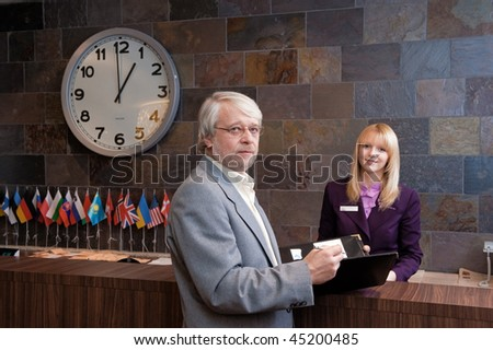 Businessman checking in at the reception desk