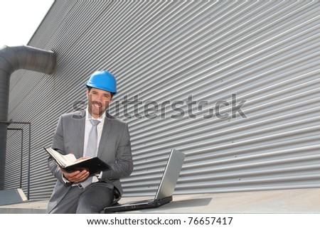 Businessman checking industrial installation