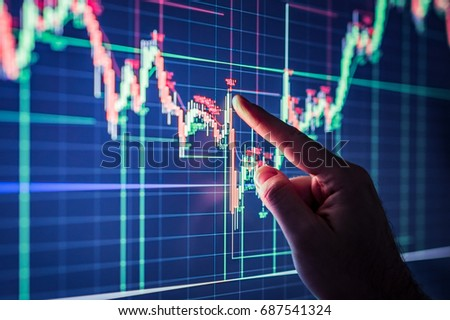 Businessman checking stock market data. Analysis economy data on forex earn graph.
