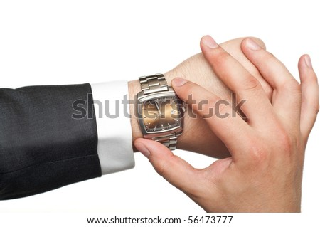 businessman checking the time isolated on white