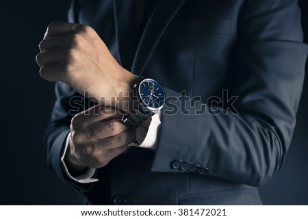 Photo of  Businessman checking time from watch