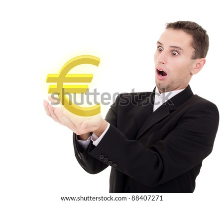 businessman chooses golden euro sign on a white background - stock photo