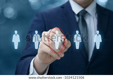Businessman chooses the employee on a virtual screen.