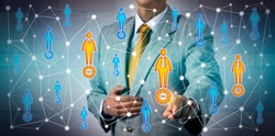 Businessman choosing male and female prospects with 100% potential in a professional network. Business and information technology concept for marketing, prospecting, performance review, HR, CRM, P2P.