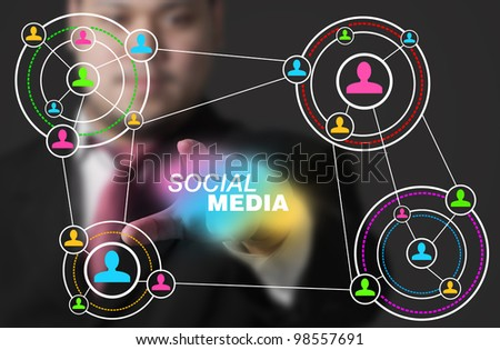 Businessman click social media concept - stock photo