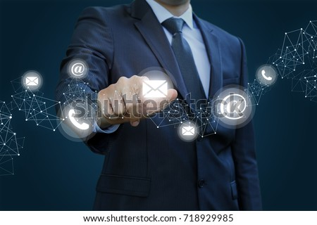 Businessman clicks on the letter. Concept contact us.