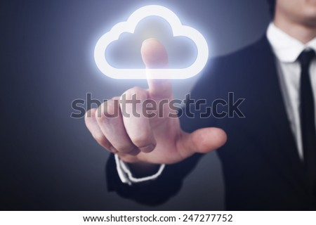 businessman clicks on the touch screen and select the cloud computing. communication. internet concept. - Shutterstock ID 247277752