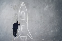 Businessman climb stair drawing rocket sketch on wall , Success, leader and winner concept .