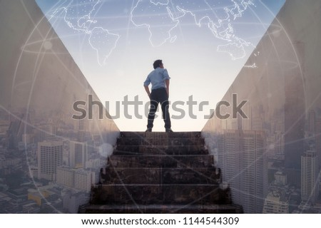 Businessman climbed on top of the stairs going to the city,  Ambitions concept and Success business. Foto stock ©