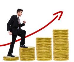 Businessman climbing a ladder of money
