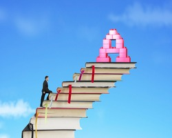 Businessman climbing books stairs toward alphabet letter A shape stack blocks, with sky clouds background.