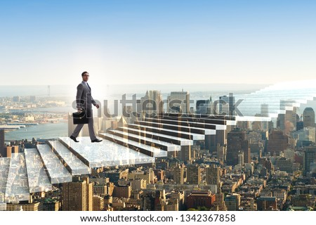 Businessman climbing career ladder over city #1342367858