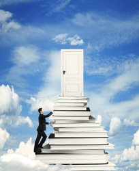 businessman climbing on stack of books with door