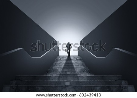 Businessman climbing stairs. Ambitions concept  #602439413