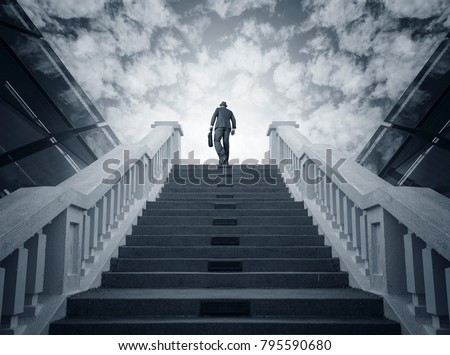 Businessman climbing stairs. Ambitions concept #795590680