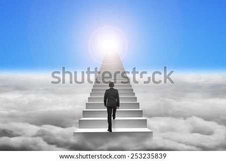 Businessman climbing the concrete stairs with blue sky sunlight cloudscape background