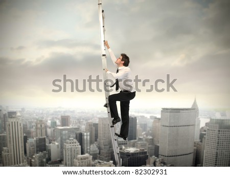 Businessman climbing up a ladder with cityscape in the background