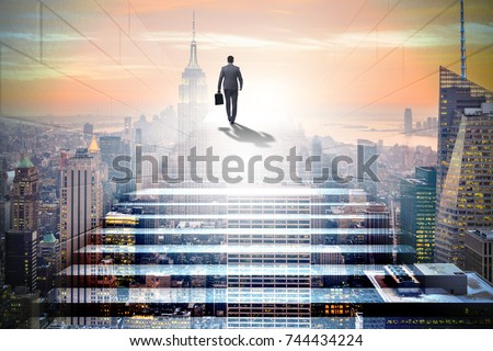 Businessman climbing up challenging career ladder in business co #744434224