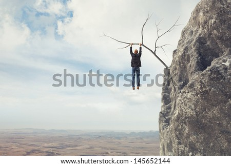 Businessman climbs a mountain