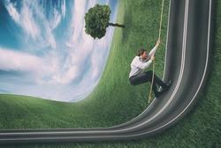 Businessman climbs a road bent upwards. Achievement business goal and difficult career concept