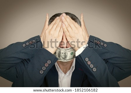 Businessman closed his eyes and ears. Mouth is closed with dollar. Corruption and bribery concept. Toned image Foto stock ©
