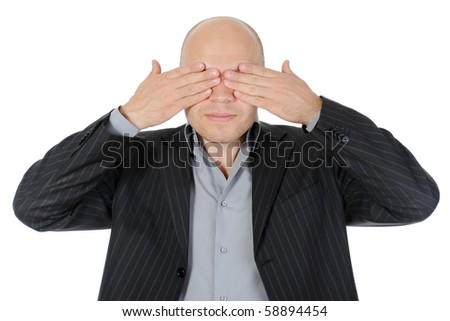 Businessman closing his eyes his hands. Isolated on white background