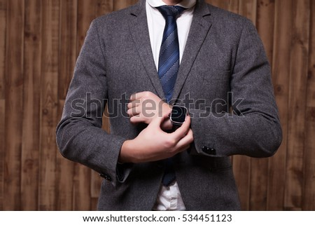 businessman clothes, businessman checking time on his watch