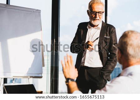 Businessman coach speaker wear suit give blank flipchart presentation, Speaker presenter consulting training persuading employees client group, Business, meeting, presentation concept.