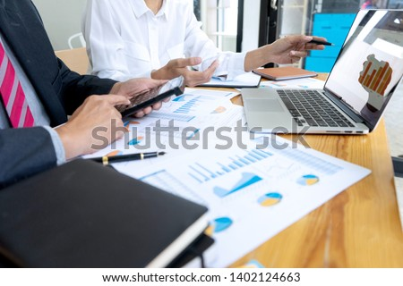 Businessman coaching office staff for business marketing plan #1402124663