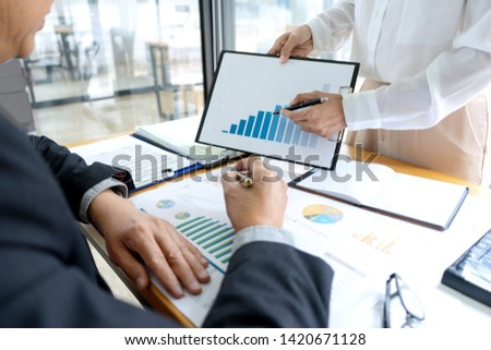 Businessman coaching office staff for business marketing plan #1420671128