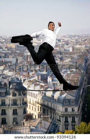 Businessman confidently walking across tight rope