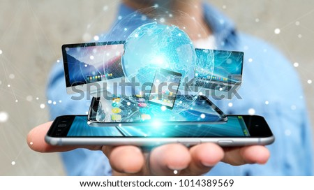 Businessman connecting tech devices and icons applications with each other 3D rendering #1014389569
