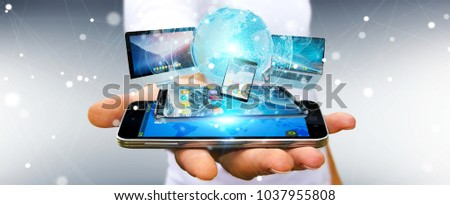 Businessman connecting tech devices and icons applications with each other 3D rendering #1037955808