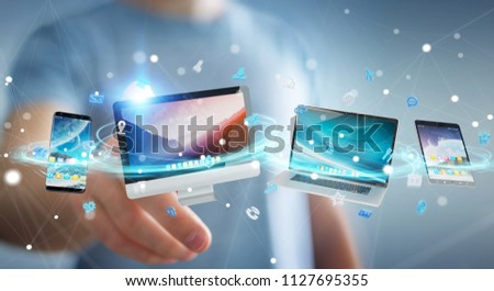 Businessman connecting tech devices and icons applications with each other 3D rendering #1127695355