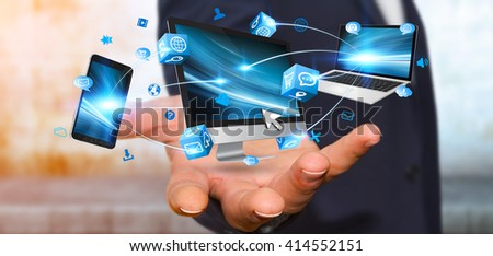 Businessman connecting tech devices computer phone and tablet '3D rendering' #414552151